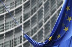 An European Union flag hangs outside the European Commission headquarters in Brussels February 13, 2014. REUTERS/Francois Lenoir