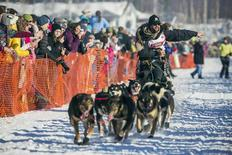 Musher Rick Casillo greets spectators during the official restart to the Iditarod dog sled race in Willow, Alaska, March 2, 2014. REUTERS/Nathaniel Wilder