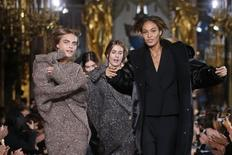 Models Cara Delevingne (L) and Joan Smalls (R) present creations by British designer Stella McCartney as part of her Fall/Winter 2014-2015 women's ready-to-wear collection show during Paris Fashion Week March 3, 2014. REUTERS/Benoit Tessier