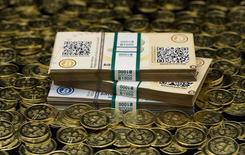 """Some of Bitcoin enthusiast Mike Caldwell's coins and paper vouchers, often called """"paper wallets"""", are pictured at his office in this photo illustration in Sandy, Utah, January 31, 2014. REUTERS/Jim Urquhart"""