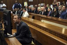 Oscar Pistorius sits in court ahead of his trial at the North Gauteng High Court in Pretoria March 3, 2014. REUTERS/Themba Hadebe/Pool