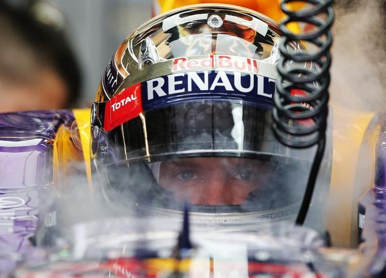 Red Bull Formula One driver Sebastian Vettel of Germany is sprayed with dried ice to keep cool during the third practice session of the Austin F1 Grand Prix at the Circuit of the Americas in Austin November 16, 2013. REUTERS/Adrees Latif