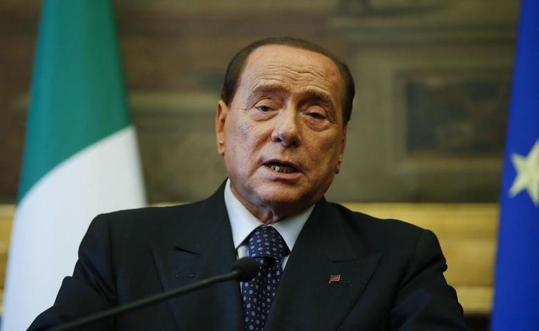 Leader of Forza Italia party Silvio Berlusconi talks to reporters at the end of the consultations with Italian Prime Minister-designate Matteo Renzi (not seen) at the Parliament in Rome February 19, 2014. REUTERS/Tony Gentile
