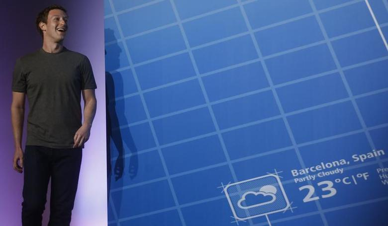 Facebook Chief Executive Officer Mark Zuckerberg smiles as he arrives at the stage to deliver a keynote speech during the Mobile World Congress in Barcelona February 24, 2014. REUTERS/