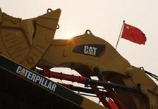 A Caterpillar excavator is displayed at the China Coal and Mining Expo 2013 in Beijing October 22, 2013. Picture taken October 22, 2013. REUTERS/Kim Kyung-Hoon