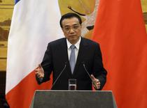 Chinese Premier Li Keqiang gives an address during a news conference with French Prime Minister Jean-Marc Ayrault (not pictured) in the Great Hall of the People in Beijing December 6, 2013. REUTERS/Mark Ralston/Pool