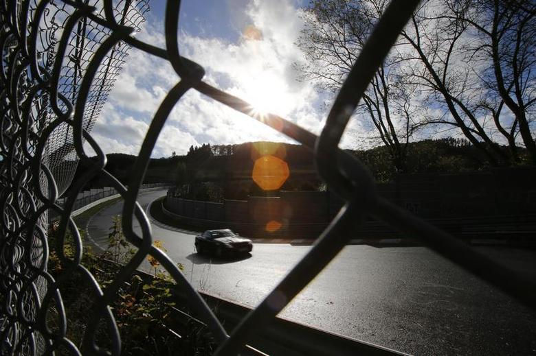 A hobbyist racing driver steers his car towards the ''Bergwerk'' section of the legendary 13-mile (21-km) Nuerburgring race track, in the western German low mountain range of the Eifel near Adenau, October 27, 2013. REUTERS/Wolfgang Rattay