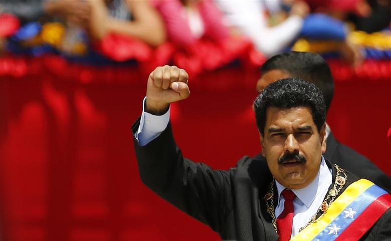 Venezuelan President Nicolas Maduro arrives at a military parade to commemorate the first anniversary of the death of Venezuela's late president Hugo Chavez in Caracas March 5, 2014. REUTERS/Jorge Silva
