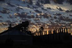 The Alcoa Aluminium Smelter is pictured before sunrise at Point Henry in Geelong, February 25, 2014. Geelong, south of Melbourne, is a microcosm of the economic crossroads at which Australia stands. REUTERS/Jason Reed