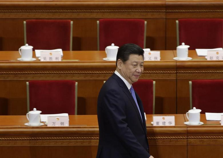 China's President Xi Jinping arrives before the opening session of the National People's Congress (NPC) at the Great Hall of the People in Beijing,March 5, 2014. REUTERS/Jason Lee