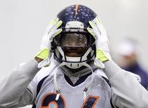 Denver Broncos cornerback Champ Bailey adjusts his helmet during their practice session for the Super Bowl at the New York Jets Training Center in Florham Park, New Jersey January 31, 2014. REUTERS/Ray Stubblebine