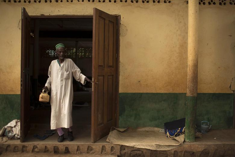 A man walks out of a mosque near Kilometre 12 (PK12) where internally displaced muslims are stranded due to the ongoing sectarian violence in Bangui March 6, 2014. REUTERS/Siegfried Modola