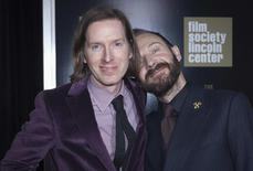 """Cast member Ralph Fiennes and director Wes Anderson (L) arrive for the premiere of """"The Grand Budapest Hotel"""" in New York February 26, 2014. REUTERS/Carlo Allegri"""