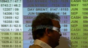 A dealer works on the trading floor at IG Index in London May 10, 2010. REUTERS/Suzanne Plunkett