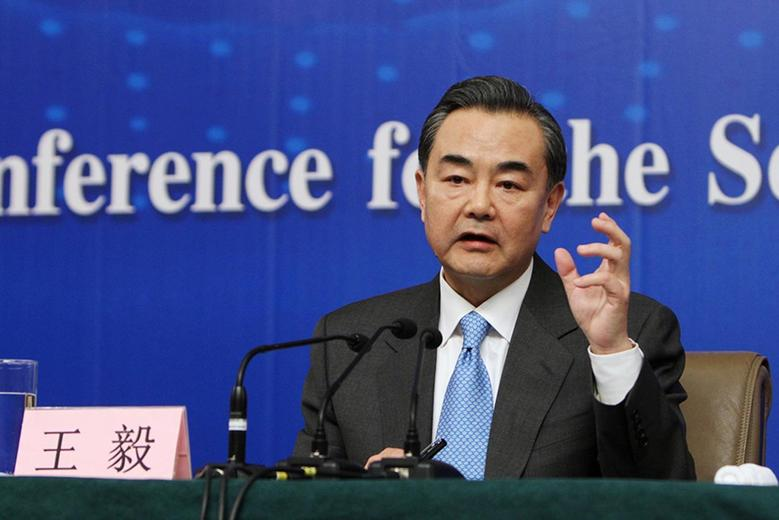 China's Foreign Minister Wang Yi gestures as he speaks during a news conference as part of the National People's Congress (NPC) in Beijing March 8, 2014. REUTERS/Stringer