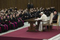 Pope Francis talks during a meeting with priests of Rome during a meeting at Paul VI's Hall at the Vatican March 6, 2014. REUTERS/Osservatore Romano