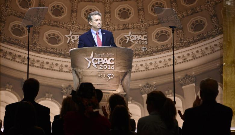 Senator Rand Paul (R-KY) pauses in his remarks as guests applaud at the Conservative Political Action Conference (CPAC) in Oxon Hill, Maryland, March 7, 2014. REUTERS/Mike Theiler