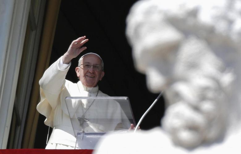 Pope Francis waves as he leads the Angelus prayer from the window of the Apostolic palace in Saint Peter's Square at the Vatican March 9, 2014. REUTERS/Max Rossi