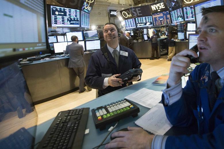 Traders work on the floor of the New York Stock Exchange March 5, 2014. REUTERS/Brendan McDermid