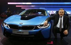 BMW CEO Norbert Reithofer poses beside the BMW i8 hybrid supercar during a media preview day at the Frankfurt Motor Show (IAA) September 10, 2013. REUTERS/Ralph Orlowski