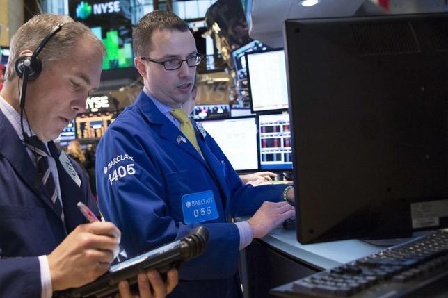 Traders work on the floor of the New York Stock Exchange March 10, 2014. REUTERS/Brendan McDermid