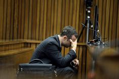 Olympic and Paralympic track star Oscar Pistorius reacts during a testimony at the North Gauteng High Court in Pretoria March 10, 2014. REUTERS/Bongiwe Mchunu/Pool
