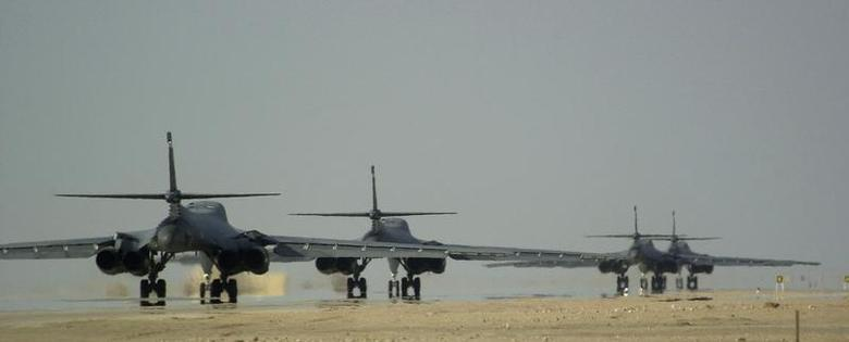 Four U.S. Air Force B-1B Lancer bombers from the 405th Air Expeditionary Wing taxi down the runway prior to taking off on a combat mission, January 3, 2002 during Operation Enduring Freedom. REUTERS/USAF-Shane Cuomo