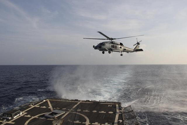 A U.S. Navy SH-60R Seahawk helicopter takes off from the destroyer USS Pinckney in the Gulf of Thailand, to assist in the search for missing Malaysian Airlines flight MH370, in this March 9, 2014 handout picture.REUTERS/U.S. Navy/Handout via Reuters