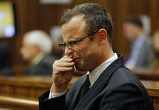 Olympic and Paralympic track star Oscar Pistorius sits in the dock at the North Gauteng High Court in Pretoria March 11, 2014. REUTERS/Kim Ludbrook/Pool