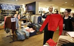 U.S. President Barack Obama looks for gifts for his family with salesperson Susan Panariello after stopping off at the GAP in New York, March 11, 2014. REUTERS/Larry Downing