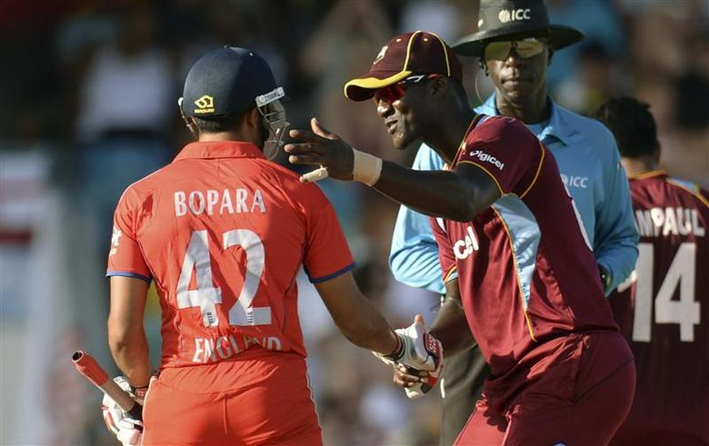 West Indies' Darren Sammy shakes hands with England's Ravi Bopara (L) during the first T20 international cricket match at Kensington Oval in Bridgetown March 9, 2014. REUTERS/Philip Brown