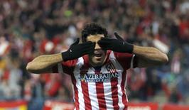 Diego Costa comemora gol do Atlético de Madri contra o Milan nesta terça-feira em Madri. REUTERS/Sergio Perez