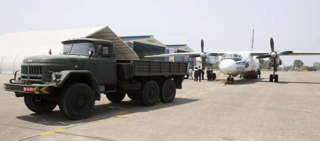 A truck tows a Vietnam Air Force AN-26 aircraft after it returned from a search area to find the missing Malaysia Airlines flight MH370, at a military airport in Ho Chi Minh city March 13, 2014. REUTERS/Kham