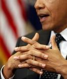 Президент США Барак Обама общается с женщинами Конгресса в Белом доме в Вашингтоне 12 марта 2014 года. Президент США Барак Обама в среду выразил надежду, что в оставшиеся дни до референдума в украинском Крыму о присоединении к России Запад и Кремль найдут дипломатическое решение, без которого Москву ждут тяжёлые последствия на мировой арене. REUTERS/Larry Downing