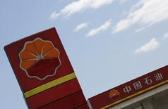 PetroChina's logo are seen at its gas station in Beijing, August 29, 2013. REUTERS/Kim Kyung-Hoon
