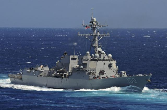 The Arleigh Burke-class guided-missile destroyer USS Kidd is seen underway in the Pacific Ocean in this U.S. Navy picture taken May 18, 2011. Kidd and the USS Pinkney have been searching for the missing Malaysian airliner and are being re-deployed to the Strait of Malacca of Malaysia's west coast as new search areas are opened in the Indian Ocean, according to officials March 13, 2014. REUTERS/U.S. Navy/Mass Communication Specialist 3rd Class Crishanda K. McCall/Handout