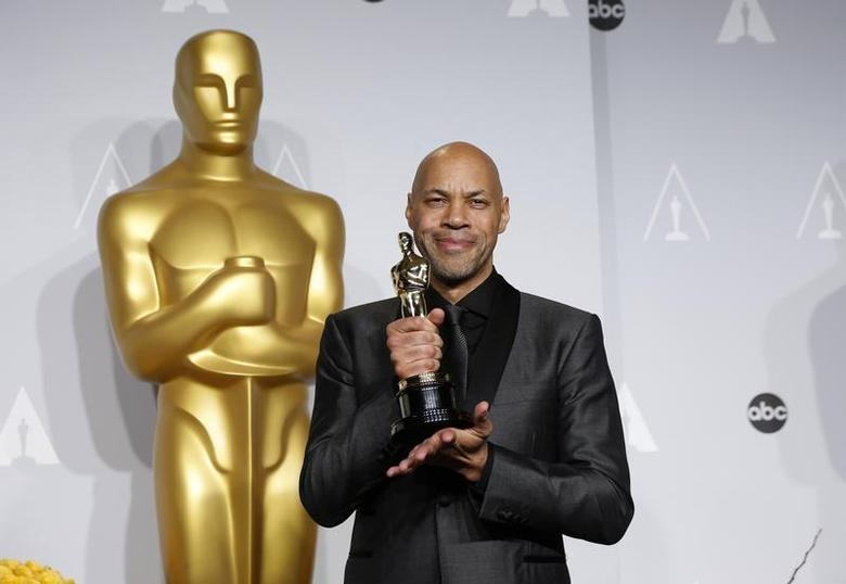 John Ridley poses with his award for best adapted screenplay for the film ''12 Years a Slave'' at the 86th Academy Awards in Hollywood, California March 2, 2014. REUTERS/Mario Anzuoni