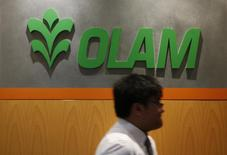 A man walks past a logo of Olam International Limited at its office in Singapore November 29, 2012. REUTERS/Edgar Su