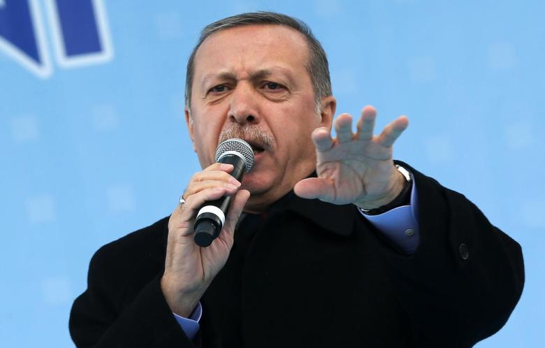 Turkey's Prime Minister Tayyip Erdogan addresses the crowd during an opening ceremony of a new metro line in Ankara March 13, 2014. REUTERS/Umit Bektas