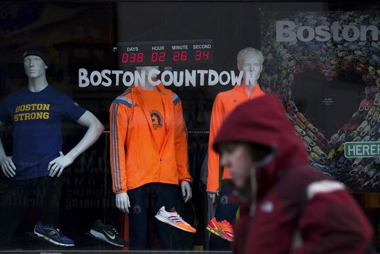 A digital clock on an athletic store front near the finish of the Boston Marathon, counts down the time to the 118th running of the Boston Marathon March 14, 2014. REUTERS/Gretchen Ertl