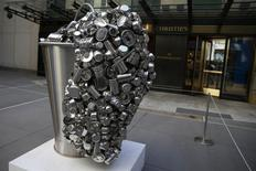 """""""Spill"""", a stainless steel vessel by Subodh Gupta is seen on display during ''The Spring 2-14 Sales of Asian Art Week"""" media preview at Christie's Auction House in New York March 13, 2014. REUTERS/Shannon Stapleton"""
