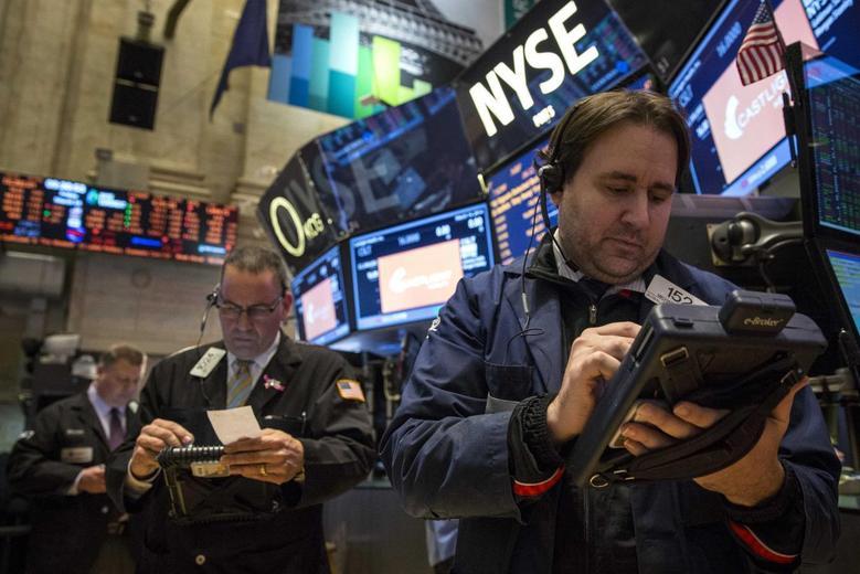Traders work on the floor of the New York Stock Exchange March 14, 2014. REUTERS/Brendan McDermid