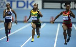 Anguilla's Shinelle Proctor, Jamaica's Veronica Campbell-Brown and Tianna Bartoletta of the U.S. (L-R) compete during the women's 60m heats at the world indoor athletics championships at the ERGO Arena in Sopot March 8, 2014. REUTERS/Dylan Martinez