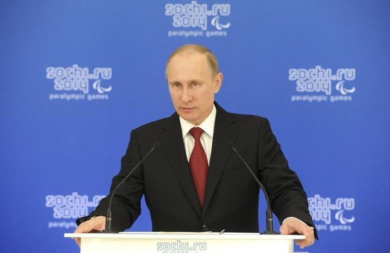 Russian President Vladimir Putin speaks during a meeting with paralympic delegations in Sochi March 13, 2014. REUTERS/Mikhail Klimentyev/RIA Novosti/Kremlin