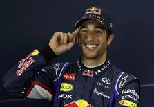 Red Bull Formula One driver Daniel Ricciardo of Australia gestures at a news conference after the qualifying session for the Australian F1 Grand Prix in Melbourne March 15, 2014. REUTERS/Brandon Malone