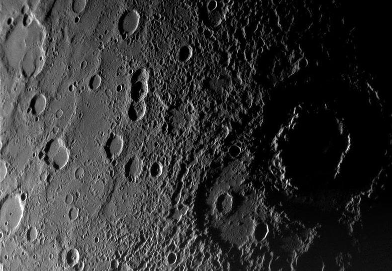 A view of the planet Mercury?s rugged, cratered landscape is pictured in this Messenger Spacecraft image released by NASA on January 16, 2008 and taken from a distance of about 18,000 kilometers (11,000 miles) on January 14, 2008, about 56 minutes before the spacecraft's closest encounter with Mercury. REUTERS/NASA/Handout