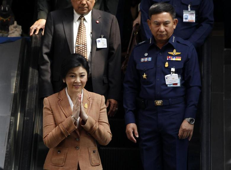 Thailand's Prime Minister Yingluck Shinawatra gestures as she leaves the Royal Thai Air Force Headquarters, after a defense meeting in Bangkok March 4, 2014. REUTERS/Chaiwat Subprasom