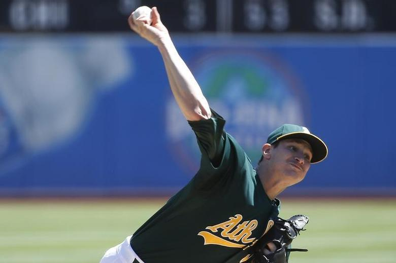 Oakland Athletics starting pitcher Jarrod Parker delivers a pitch against the Texas Rangers during the first inning of their the MLB American League baseball game in Oakland, California September 4, 2013. REUTERS/Stephen Lam