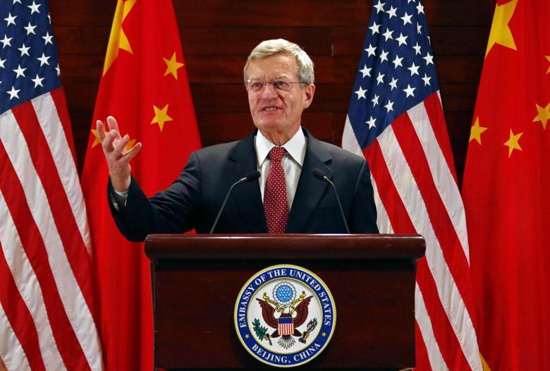 U.S. Ambassador to China Max Baucus gestures in front of Chinese and American national flags during a news conference at the U.S. Embassy, upon his arrival to his new post, in Beijing, March 18, 2014. REUTERS/Petar Kujundzic
