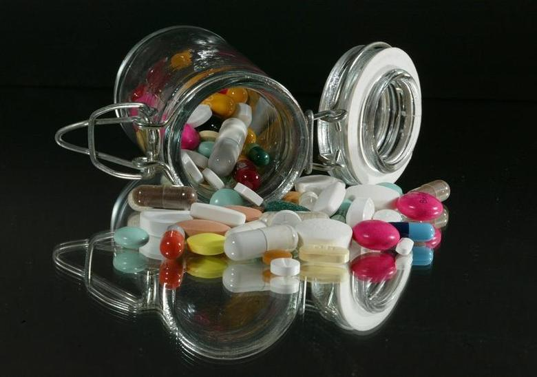 Medical illustration. Pills of all kinds, shapes and colours, March 2003. REUTERS/Jacky Naegelen/Files